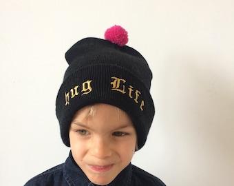 HUG LIFE Kids Hat Childrens Cap with Pom Pom in Acrylic One Size 2 Years Plus Unisex