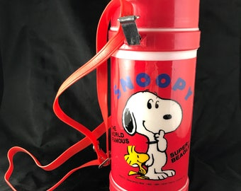 1985 Snoopy, The Word Famous Super Beagle. Water Canteen/Thermos Bottle. With shoulder strap. Red and White