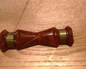 Vintage brown carved Bakelite & brass bar brooch