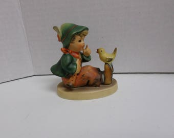 Hummel Figurine Boy with bird on feet singing lessons has a Z on bottom Excellent Condition