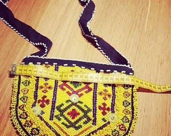 Afghan ethnic bag of beads in triangle.