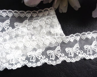 1 1/2 inch wide mesh white lace trim selling by the yard