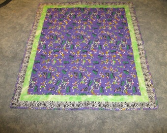 Unique Child Size Lap Quilt Made from a Vintage Fabric