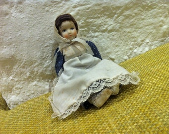 Vintage porcelain doll / fabric body
