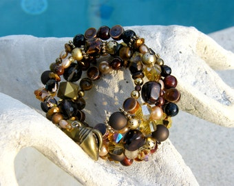 Beaded Memory Wire Bracelet - Browns and Golds with brass ornaments, crystals