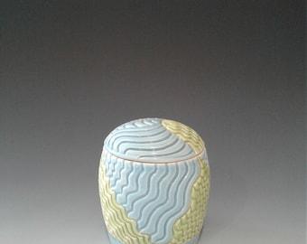 Porcelain wheel thrown jar with lid