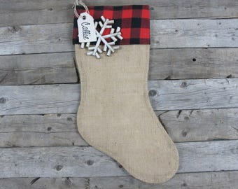 Burlap stocking with buffalo plaid cuff and a rustic snowflake and name tag