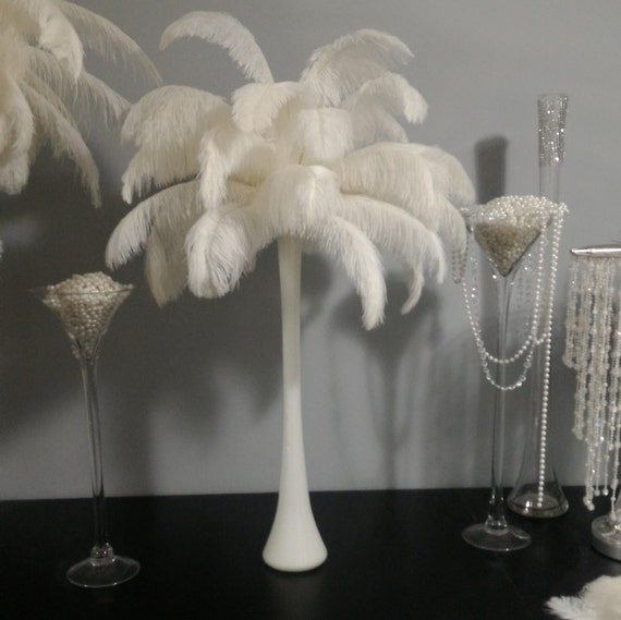 Ostrich feather centerpiece with white eiffel tower vase