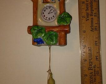 Bisque cuckoo clock, wall vase