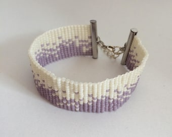 Off white and purple cuff style bracelet