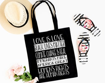 Love Is Love Black Lives Matter Climate Change Is Real Immigrants Make America Great Women's Rights are Human Rights Cotton Tote Bag