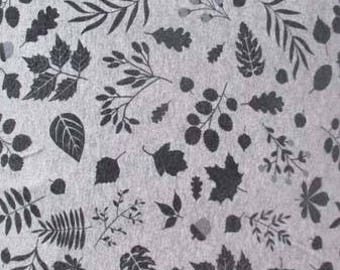 Jersey patterns leaves on a gray mottled background - 50cm