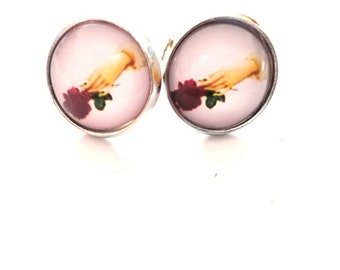 Earrings hand with rose