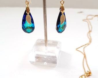 Swarovsky Pendant and Earrings set. Bermuda Blue Swarovsky crystal 24x12mm faceted Teardrop earrings,Goldfield chain and elements.
