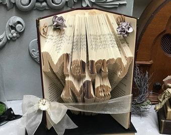 Folded book art, paper gift, book origami, book fold, book, proposal ideas, book sculpture, folded book, book origami, book sculpture,
