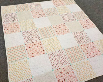 Studio Throw quilt kit featuring Marshmallow backgrounds by Bonnie and Camille