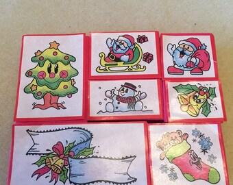 Seven Christmas Stamps.Tree,Santas,Snowman,Bell,Stocking & Ribbon.