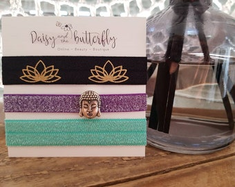 Fold over elastic hair ties with decorative charms.