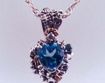 Blue Topaz Mechanical Heart Necklace