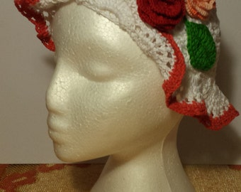 Knitted hat with flowers.