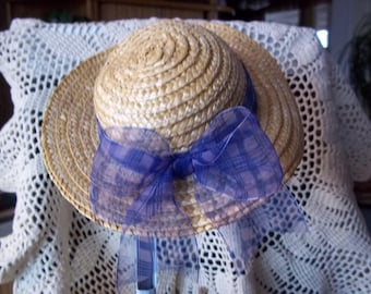 Pretty Little Straw Hat with a Big Bow on the back
