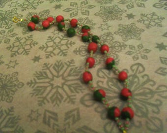 Bracelet made of beads and polymer clay pink and khaki