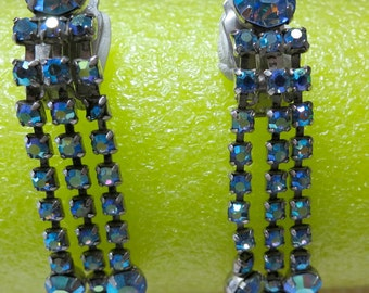 "vintage dangle clip on earrings,blue aurora borealis rhinestones. 1 larger stone, 3 dangle strands.  2.5"" ins long . HOTS12.7-7.9"