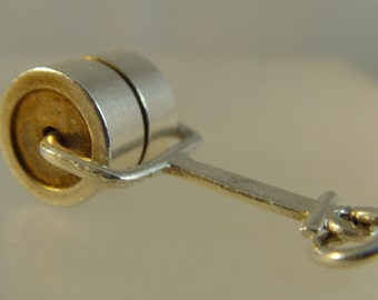 Vintage 1960s silver grass roller charm