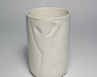 Feminine Silhouette Sculpted into a Glazed Porcelain Vessel