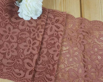 Light rust coloured stretch lace sold by the meter