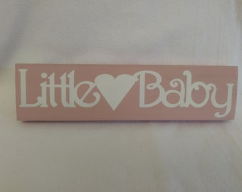 Love Little Baby Girl On Wood Plaque. Pink in Color