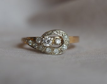 Gorgeous and shimmering vintage 14K yellow and white gold Diamond cluster swirl ring
