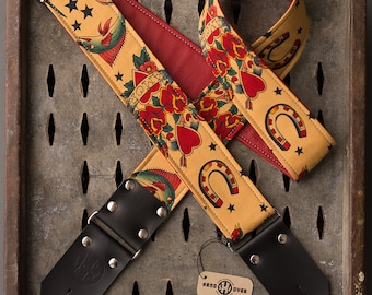"Tattoo Series 2"" tan fabric on red leather ""Amor"" guitar strap"