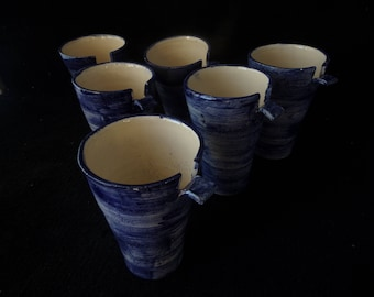 mug white cobalt blue with a small handle under which you slide your finger to hold your cup