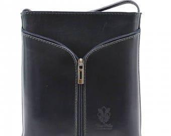 An elegant Italian made handbag/ cross body bag in deep navy blue.