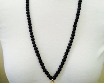 Long Black Glass Beaded Necklace with Black and Beige Teardrop Agate Pendant Wrapped in Gold