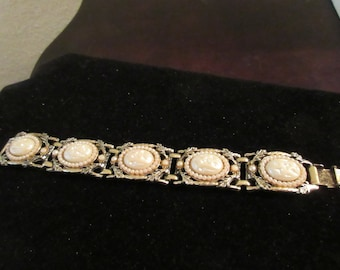 Chunky vintage white and silver tone link bracelet with small pearling detail and fold over clasp. Large, heavy duty piece.