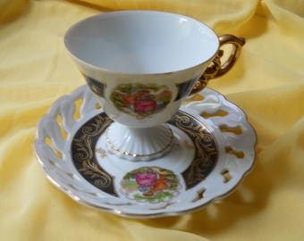 Footed teacup with saucer
