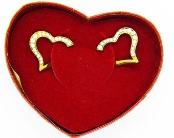 Vintage Avon open heart earrings.  the earrings are split to look like they go through the ear.