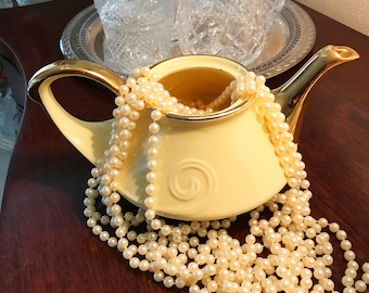 Pearl China 22kt gold and yellow teapot with no lid. Use it as a shabby chic flower vase! Made im USA