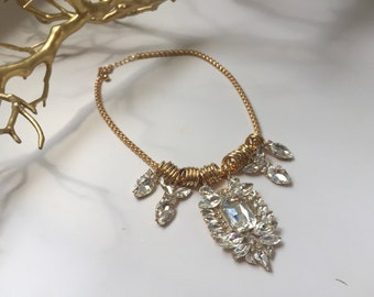 Gold necklace with crystal charms