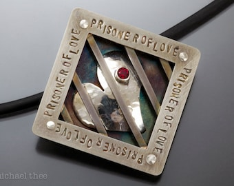 Prisoner of Love Pendant: fabricated sterling silver and red topaz, heart, devoted, locked, restrained, committed, safe, secure