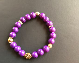 "Purple lovers:  8 inch Purple Glass beads with metallic accents 8"" stretch bracelet"