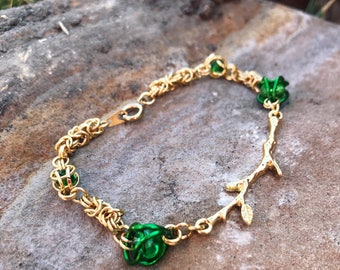 Gold and green chainmaille bracelet with gold tree branch