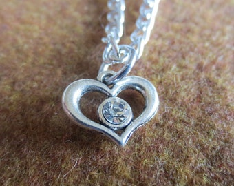 A sweet small heart with a beautiful rhinestone in the middle necklace