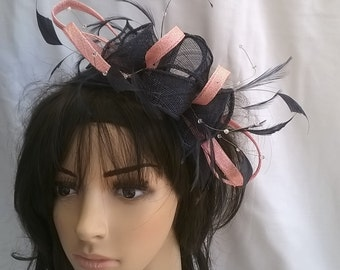 Stunning Sinamay and  Feather Fascinator Rosette Leaves,and crystal stamens