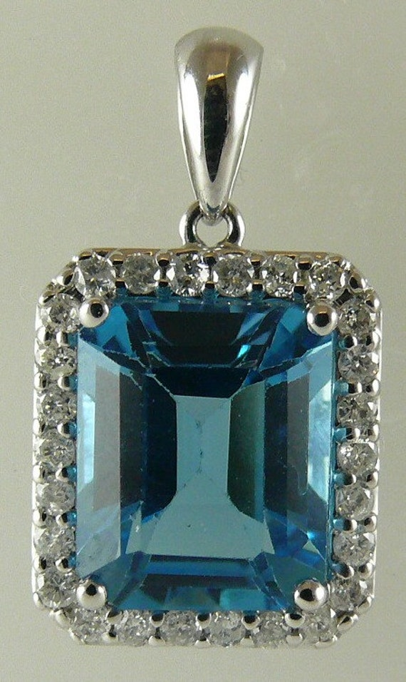 Blue Topaz 6.19ct Pendant with Diamonds 0.37ct 18k White Gold
