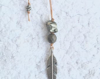 Pretty pyrite, hematite, and feather charm necklace