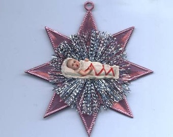 Genuine Vintage Scrap Baby Girl and Tinsel Ornament on Pink Dresden Star