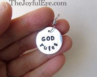 God rules. Christian inspirational charm in fine silver.  Hand stamped silver charm.